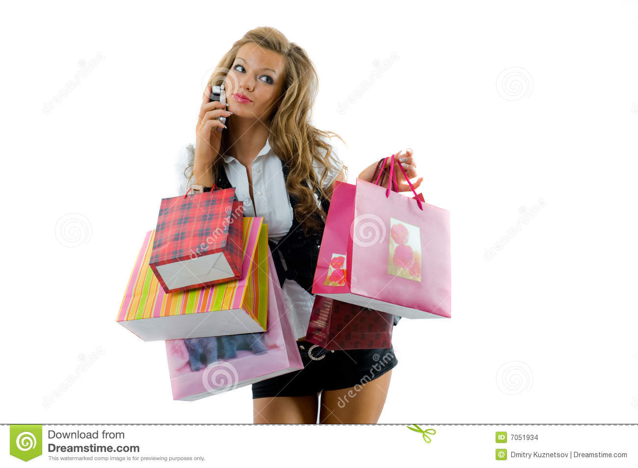 Close-up of happy young woman on a shopping spree. Talking by phone ... Smiling Dog And Cat