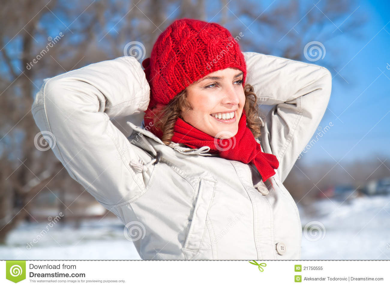 Happy young woman on the snow sunny day