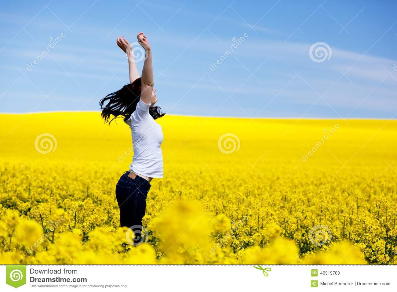Happy young woman on spring field. Success