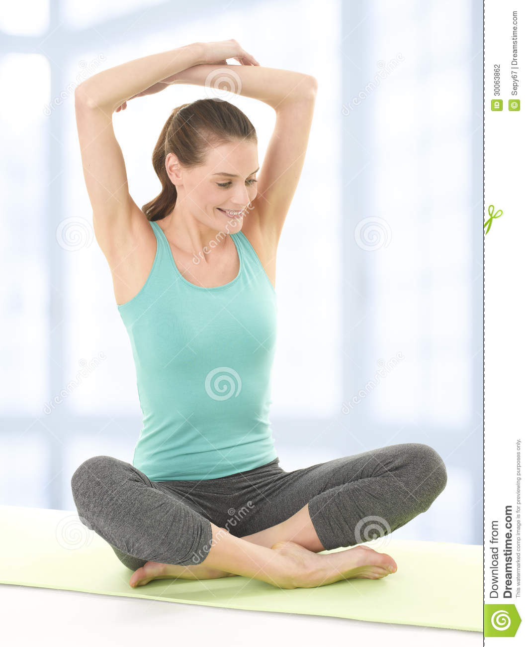 Happy Young Woman Stretching Arms On Yoga Mat Stock