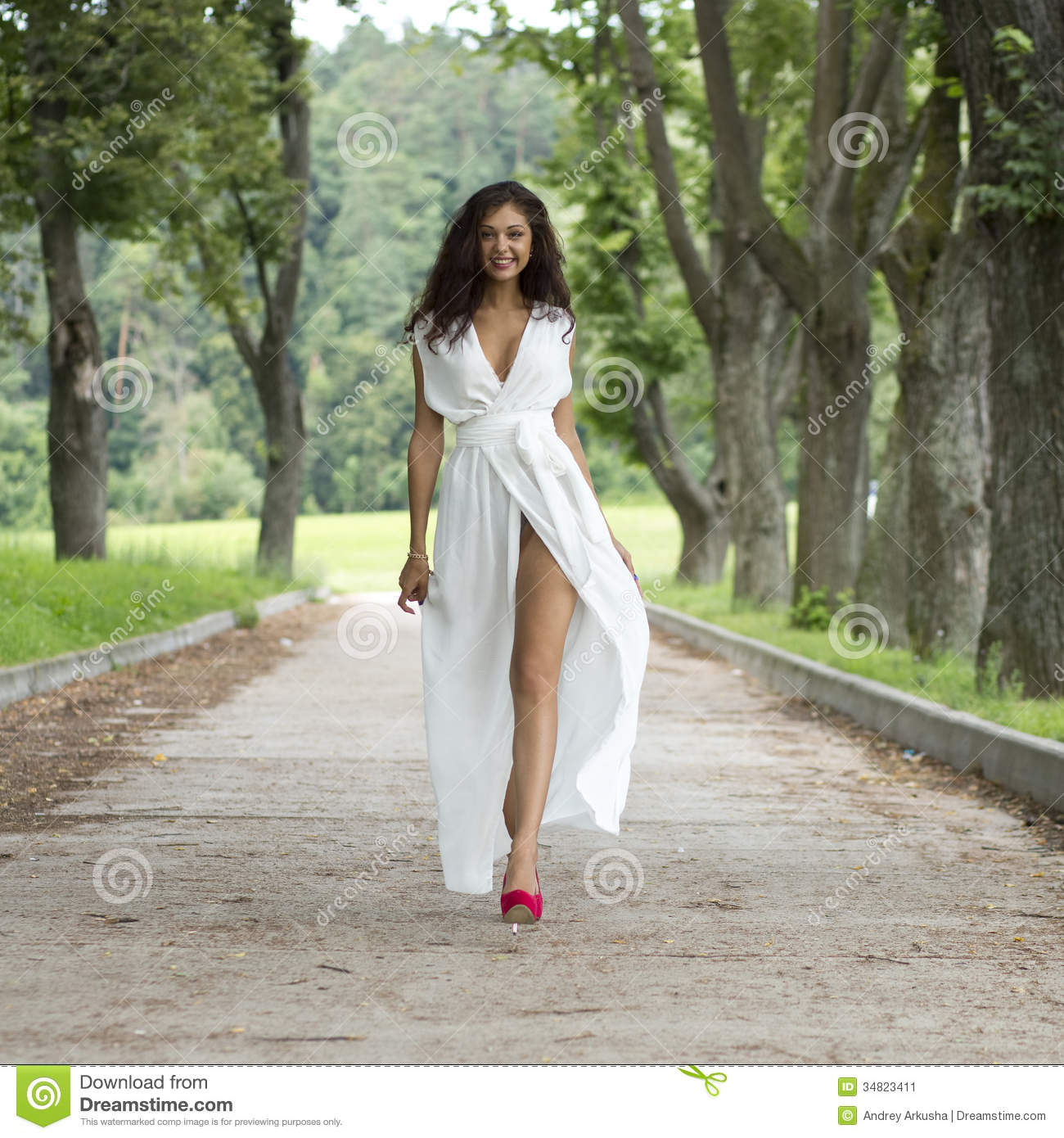 happy young woman walking on the summer park stock image Haystack Outline Haystack Outline