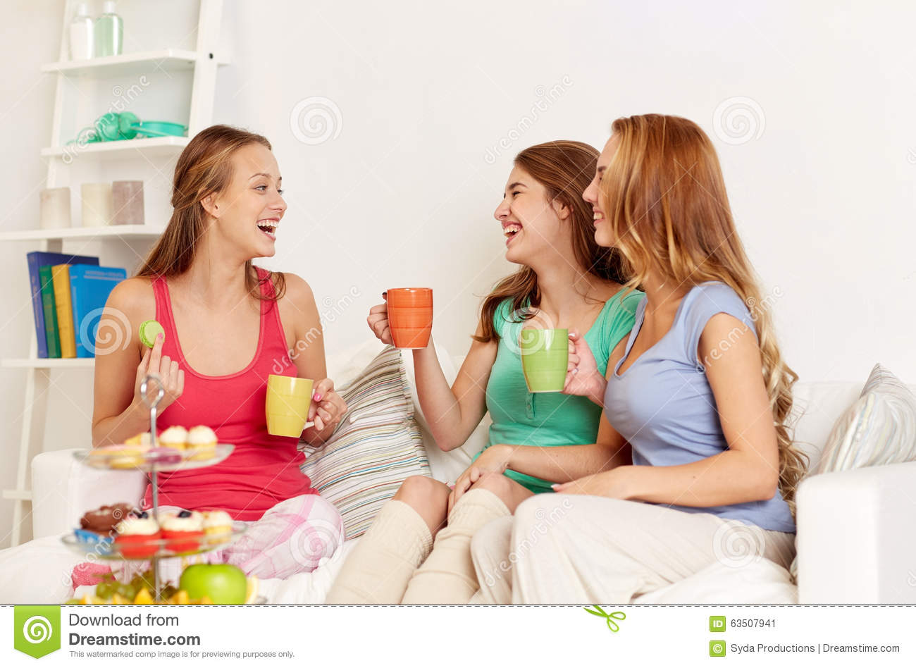 Happy young women drinking tea with sweets at home stock image image 63507941 - Teenager girl simple home ...
