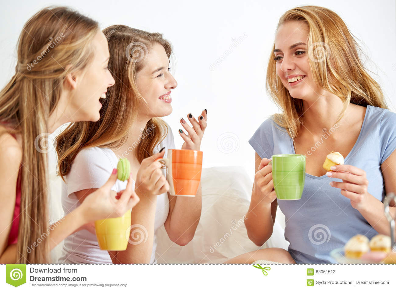 Young Women Drinking Tea And Gossiping At Home Royalty ...