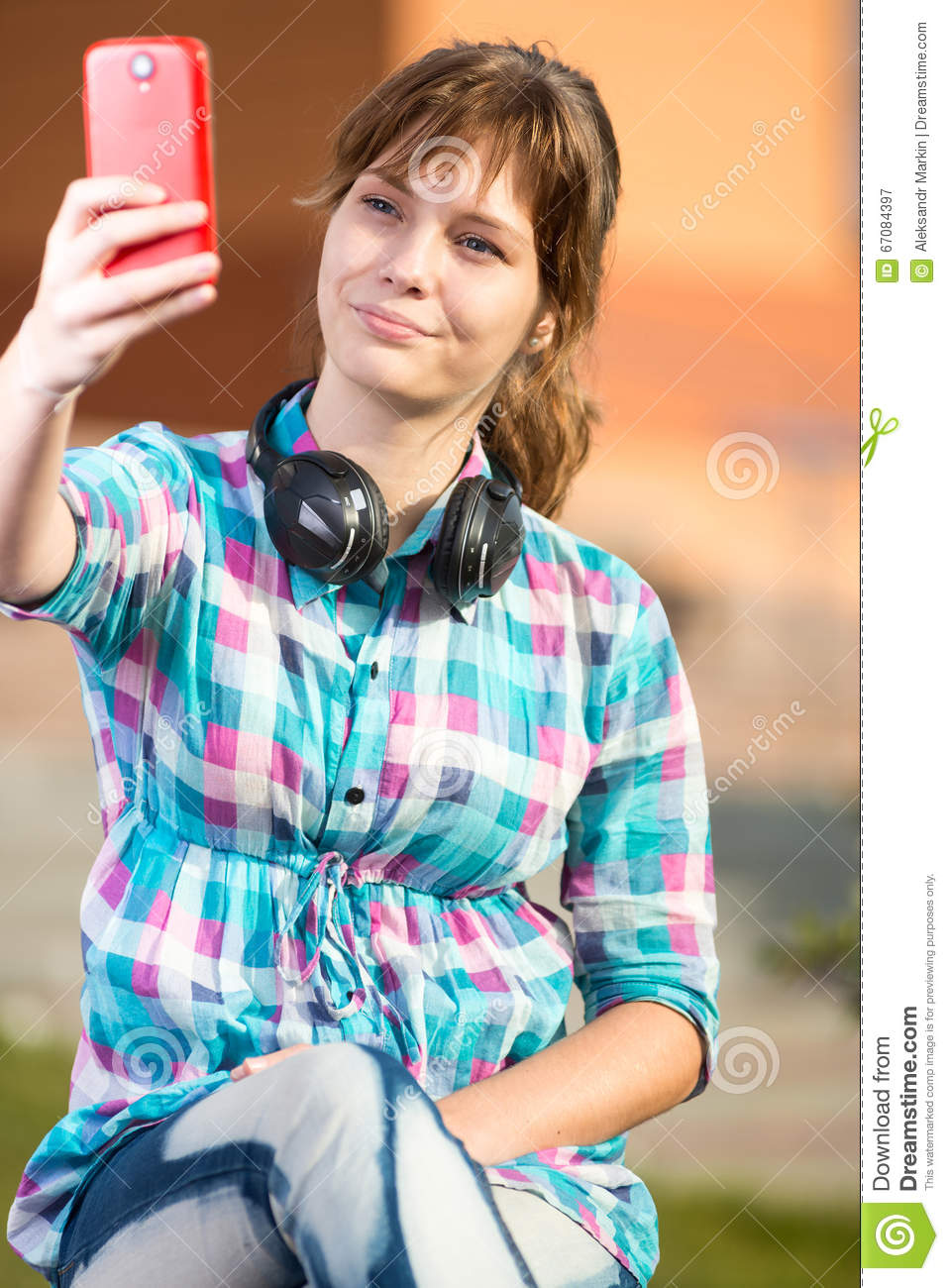 Happy Girl Taking Picture With Cell Phone Stock Photo
