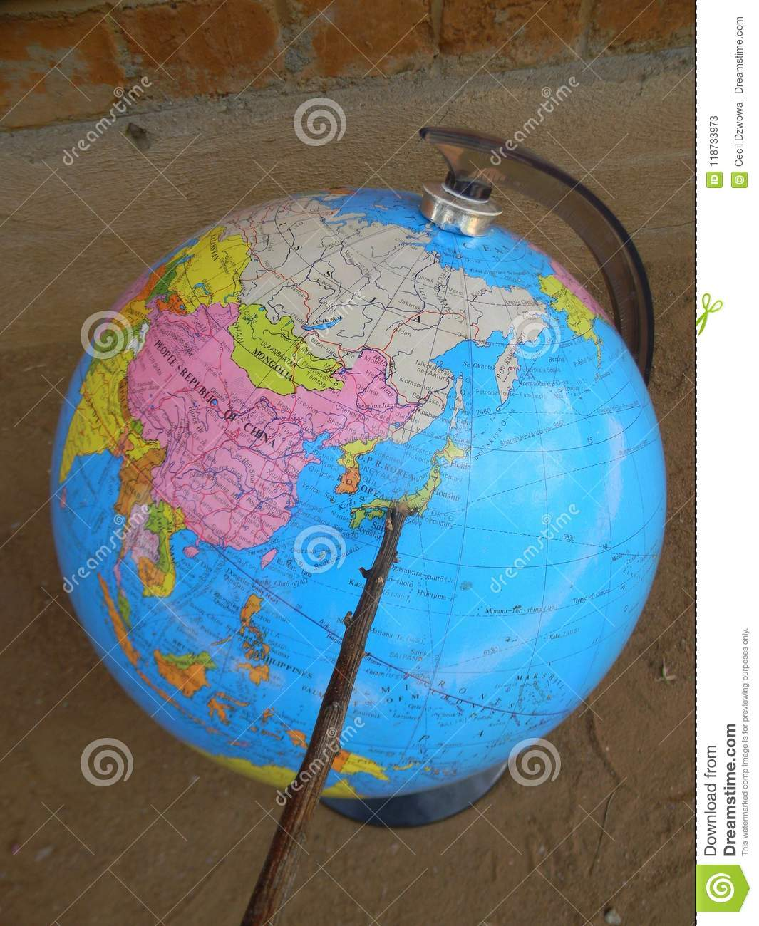 Pointer showing Japan on globe world map.