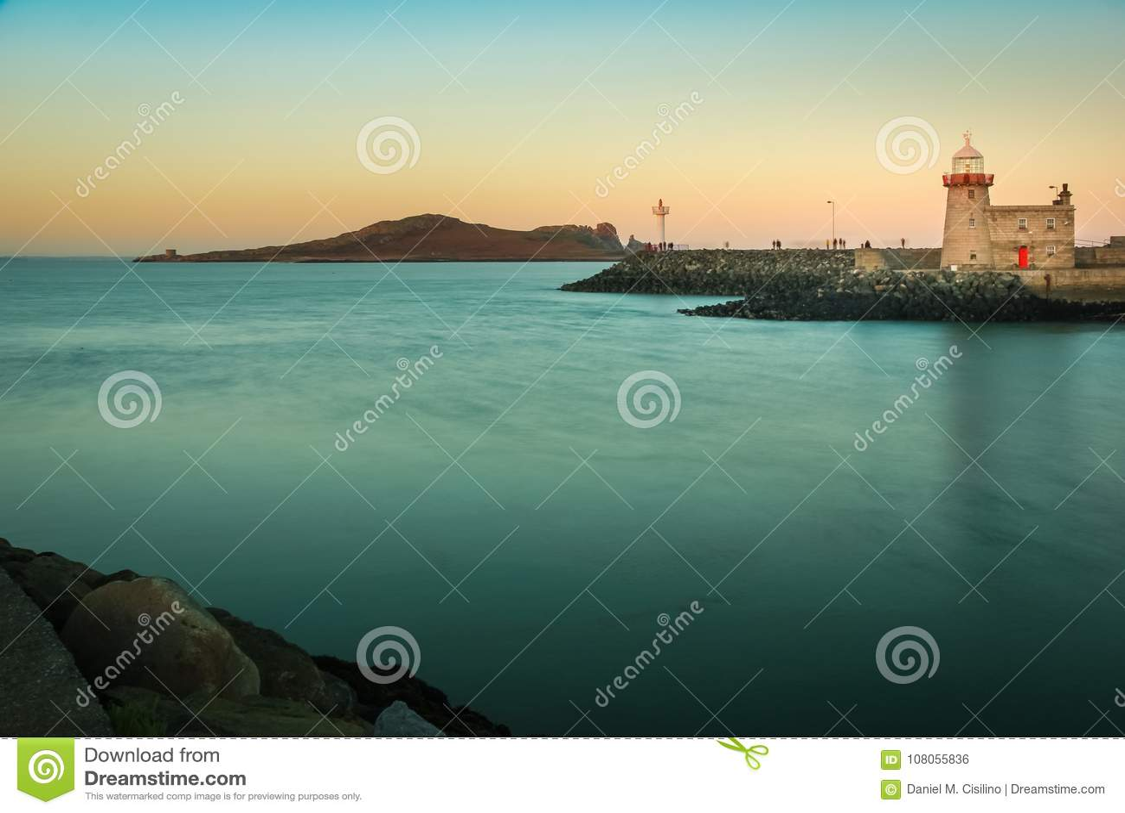 Harbour lighthouse at sunset. Howth. Dublin. Ireland