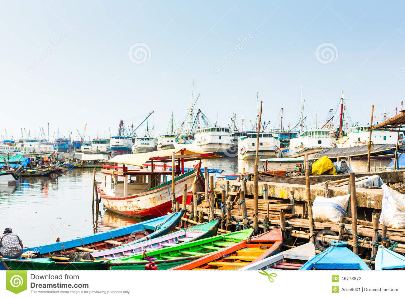 Sunda Kelapa old Harbour with fishing boats, ship and docks in Jakarta ...