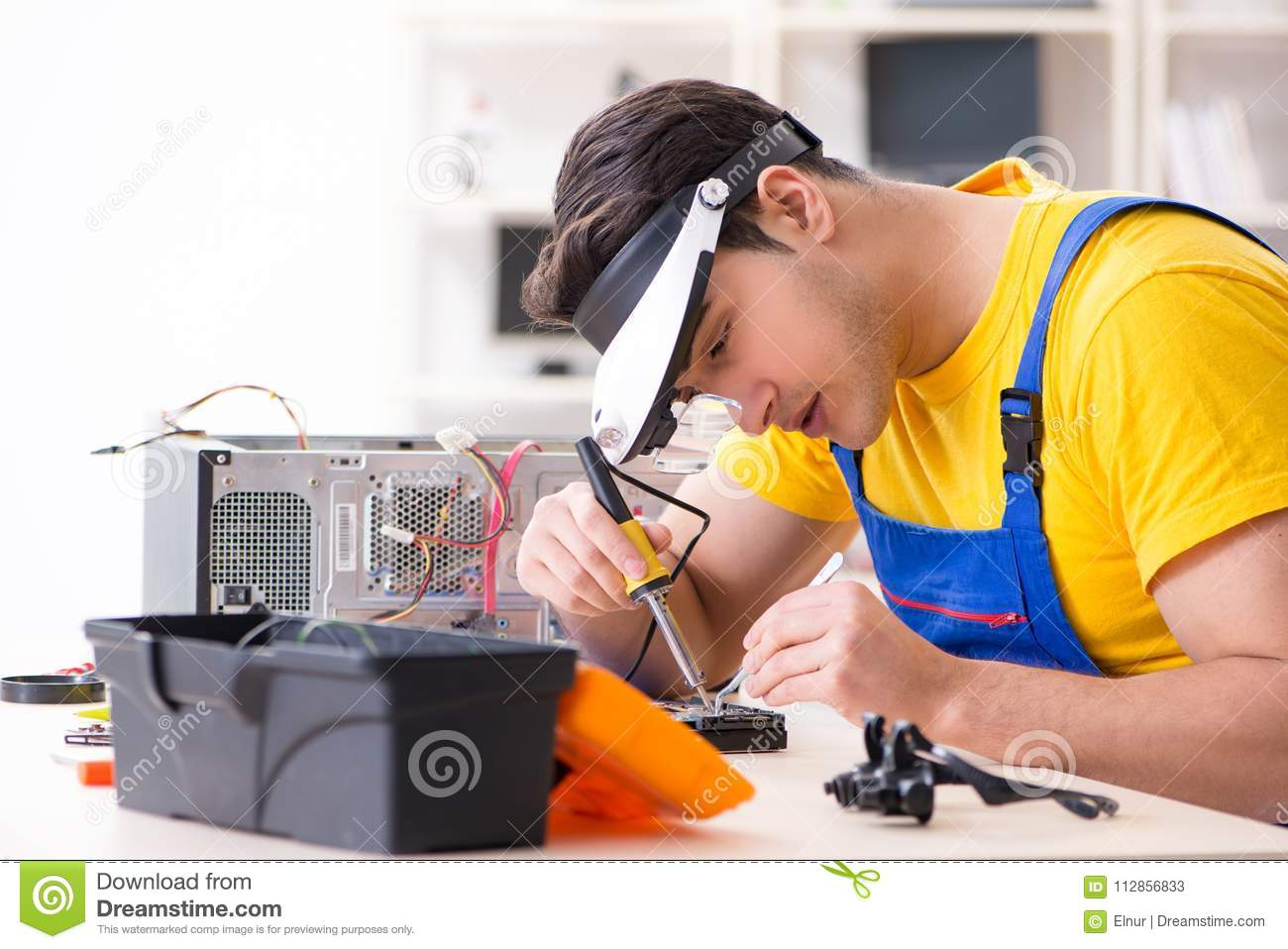 The Hard Drive Repair And Data Recovery Specialist Working