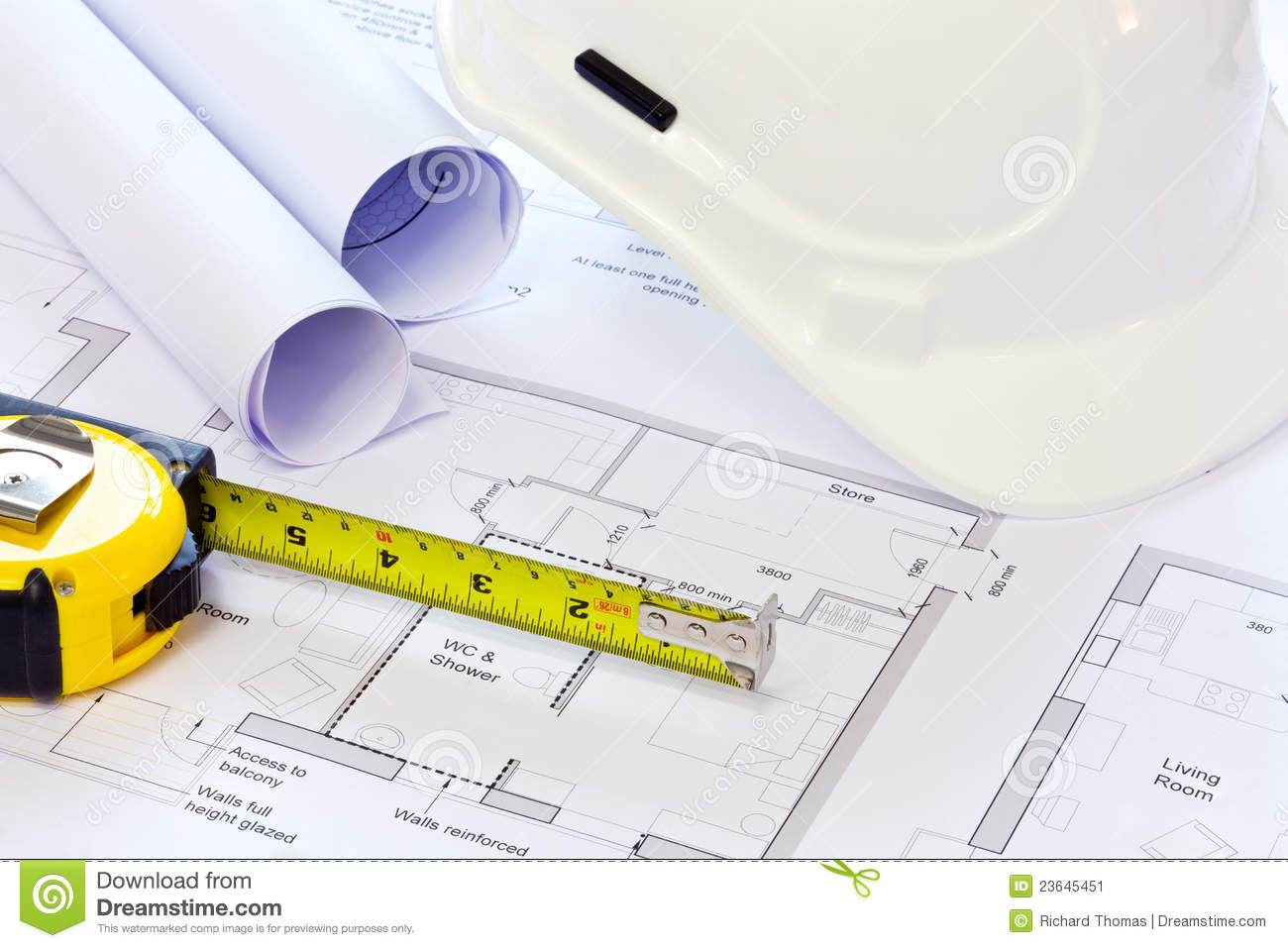Hard hat and building plans stock image image 23645451 for Stock house plans