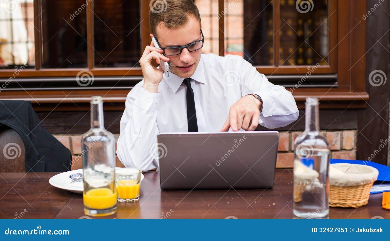 Hard Working Businessman In Restaurant. Stock Image ...