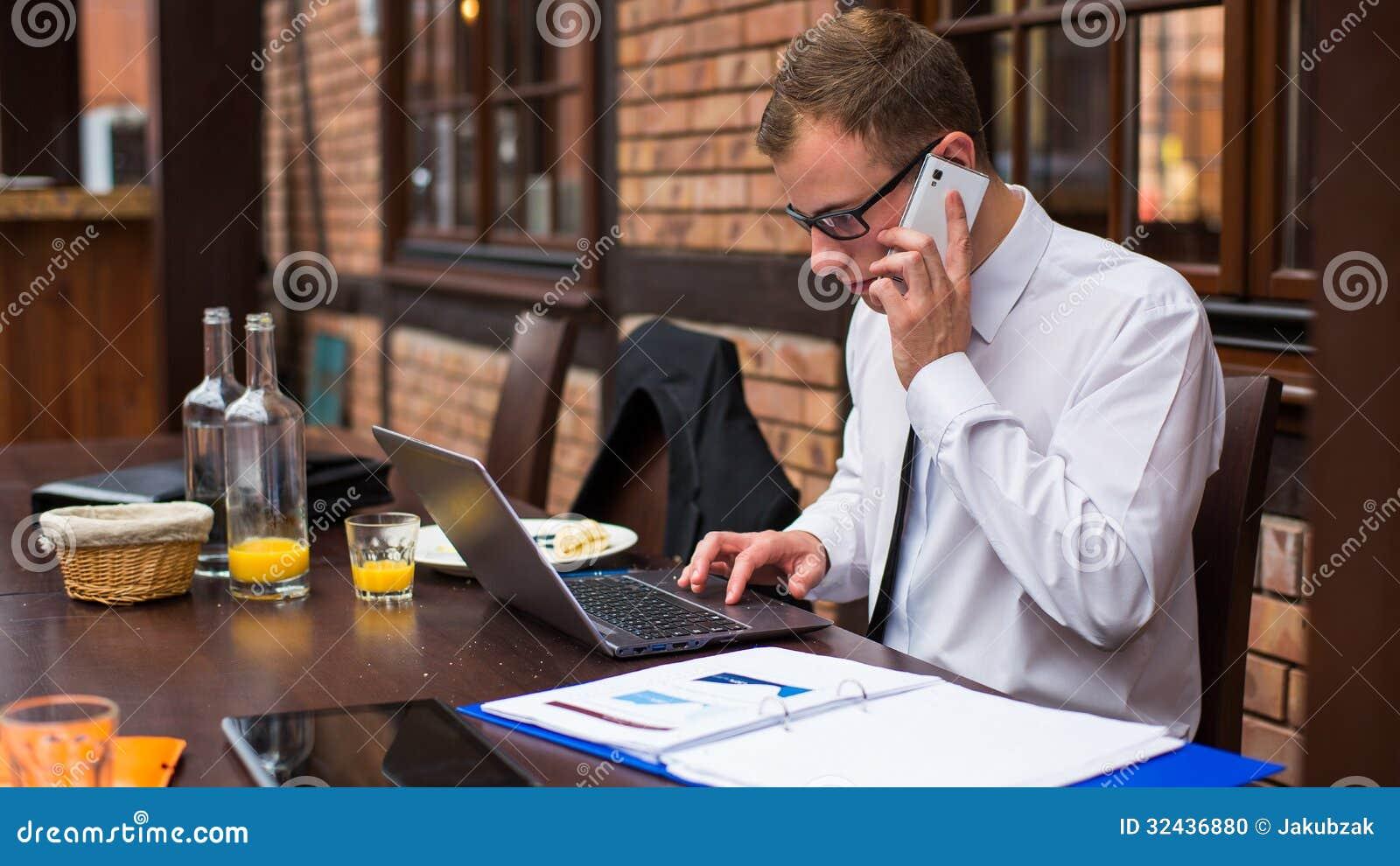 Hard Working Businessman In Restaurant. Stock Photo ...