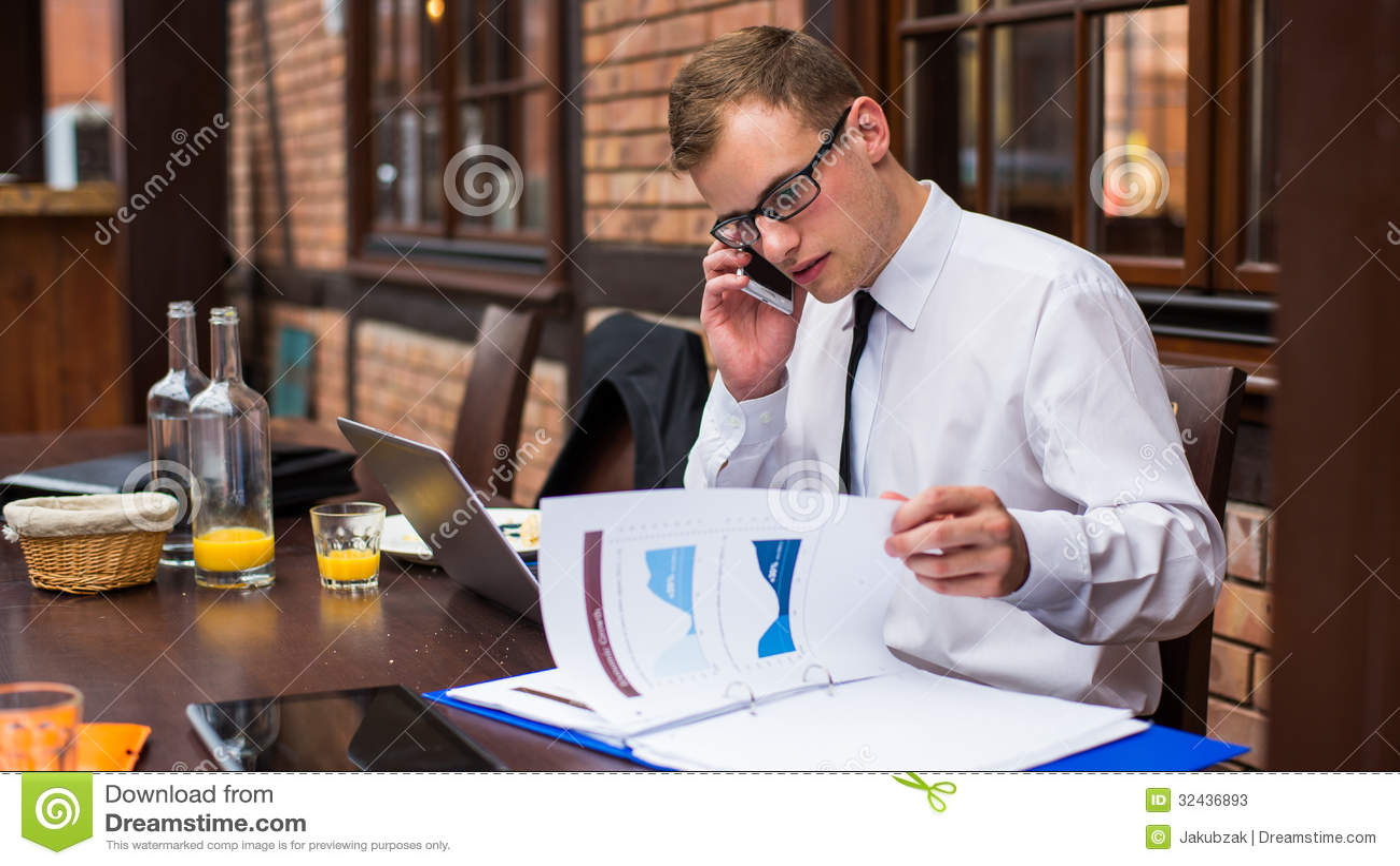 Hard Working Businessman In Restaurant. Stock Photos ...