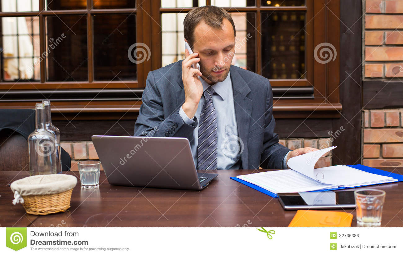 Hard Working Businessman In Restaurant With Laptop And ...