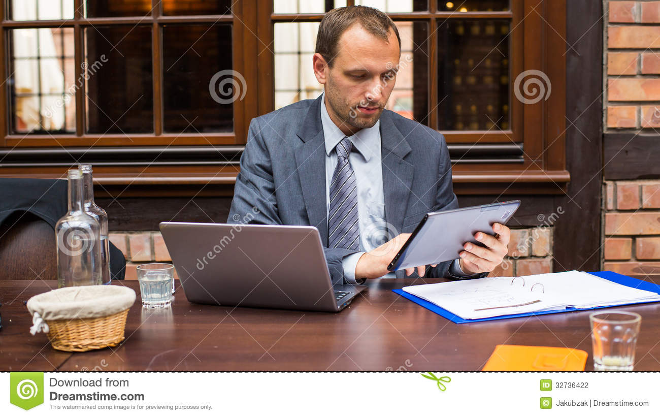 Hard Working Smiling Businessman In Restaurant With Laptop ...