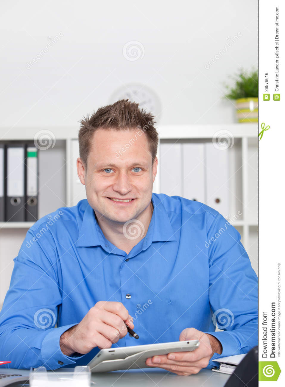Hard Working Young Businessman At His Desk Royalty Free ...