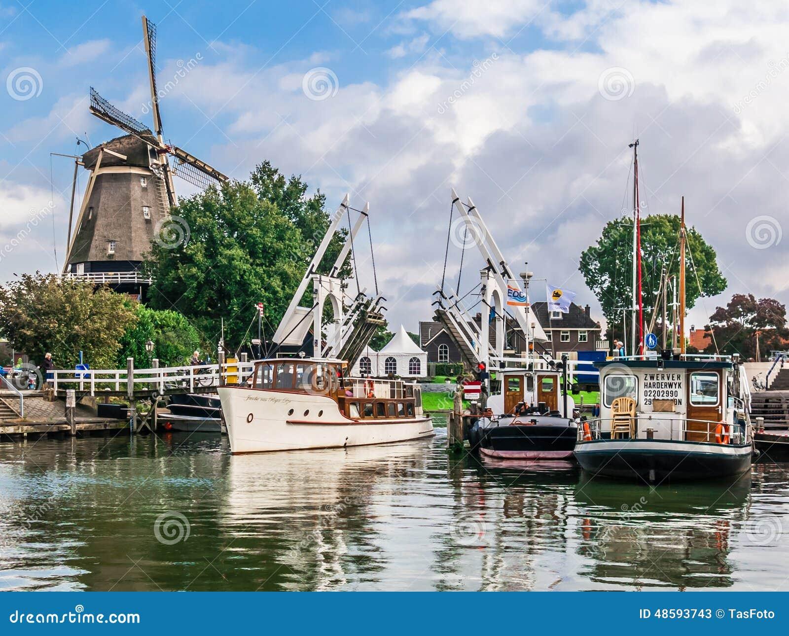 Harderwijk harbor and windmill, Holland