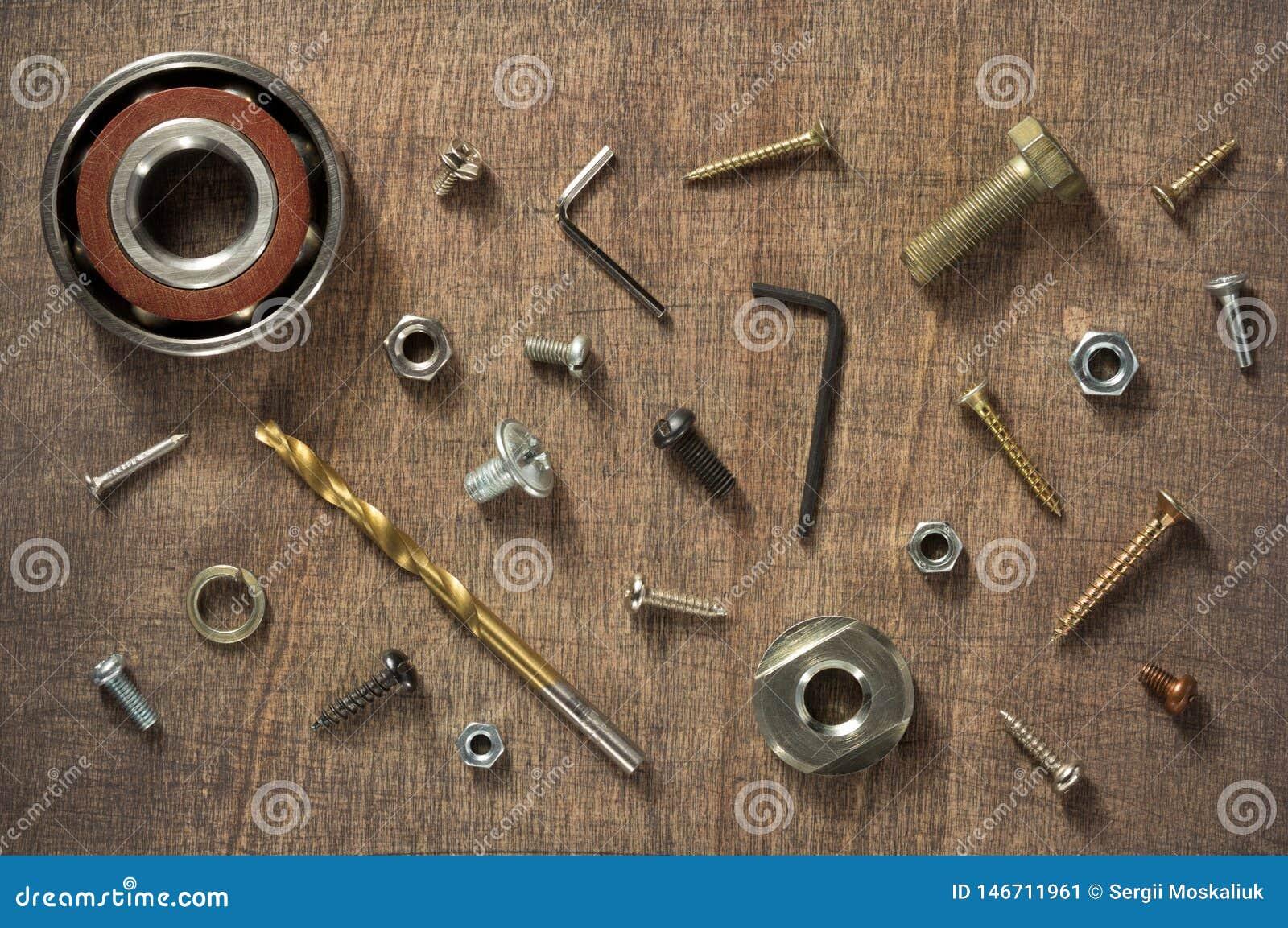 Hardware tools and screws at wood