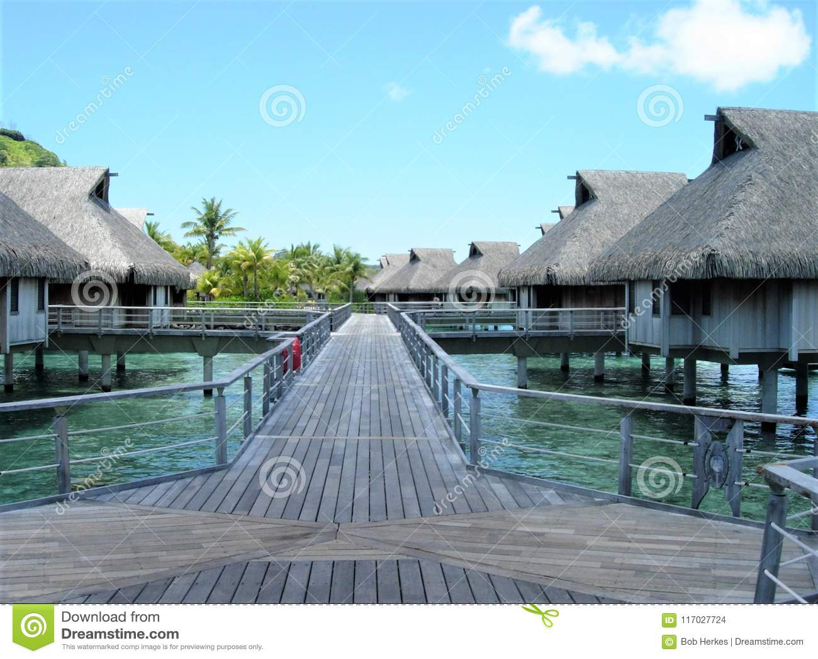Hardwood path to over water Bungalows Bora Bora resort