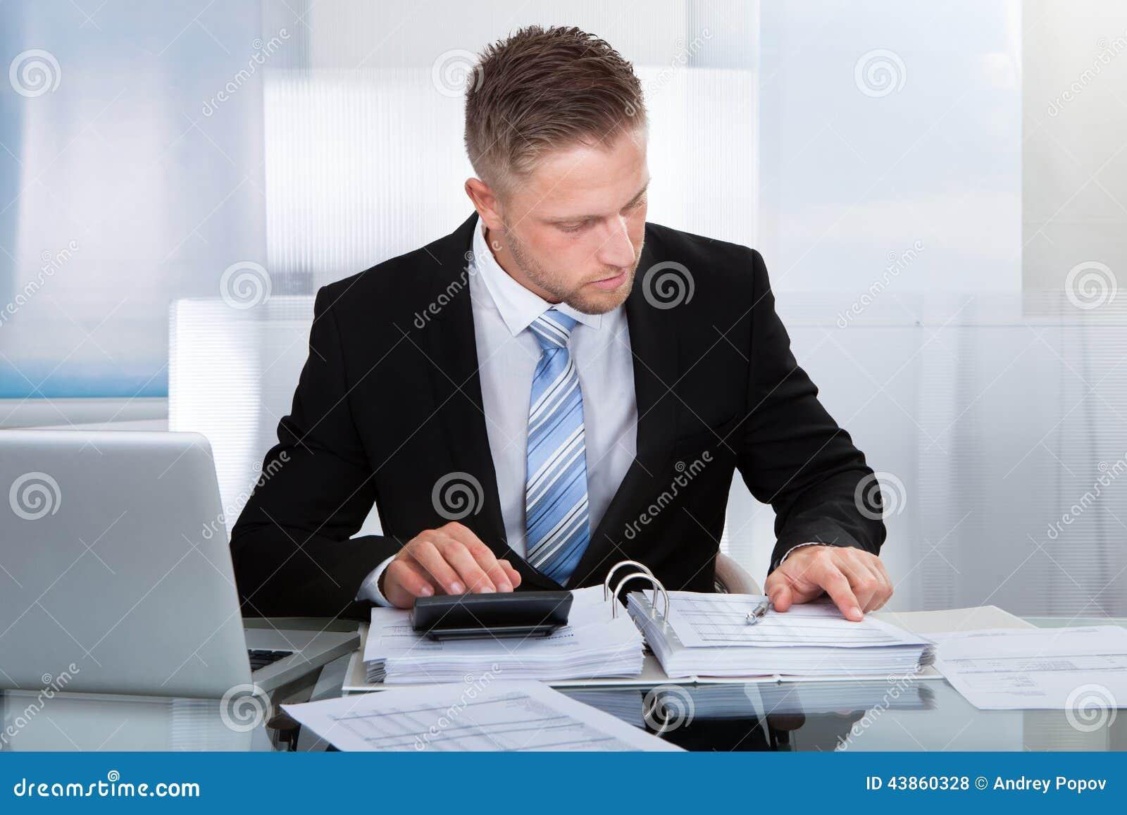 Hardworking businessman analyzing a report