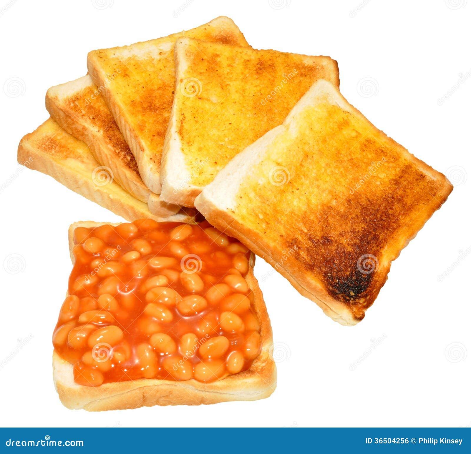 Haricots cuits au four sur le pain grillé