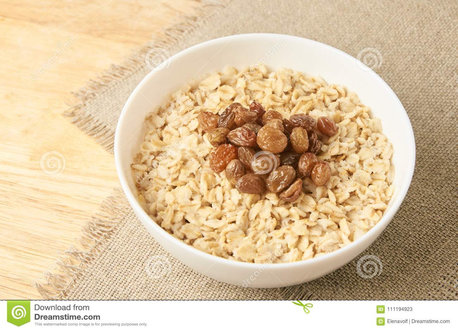 Harina de avena con las pasas Fondo sano delicioso del neutral del desayuno