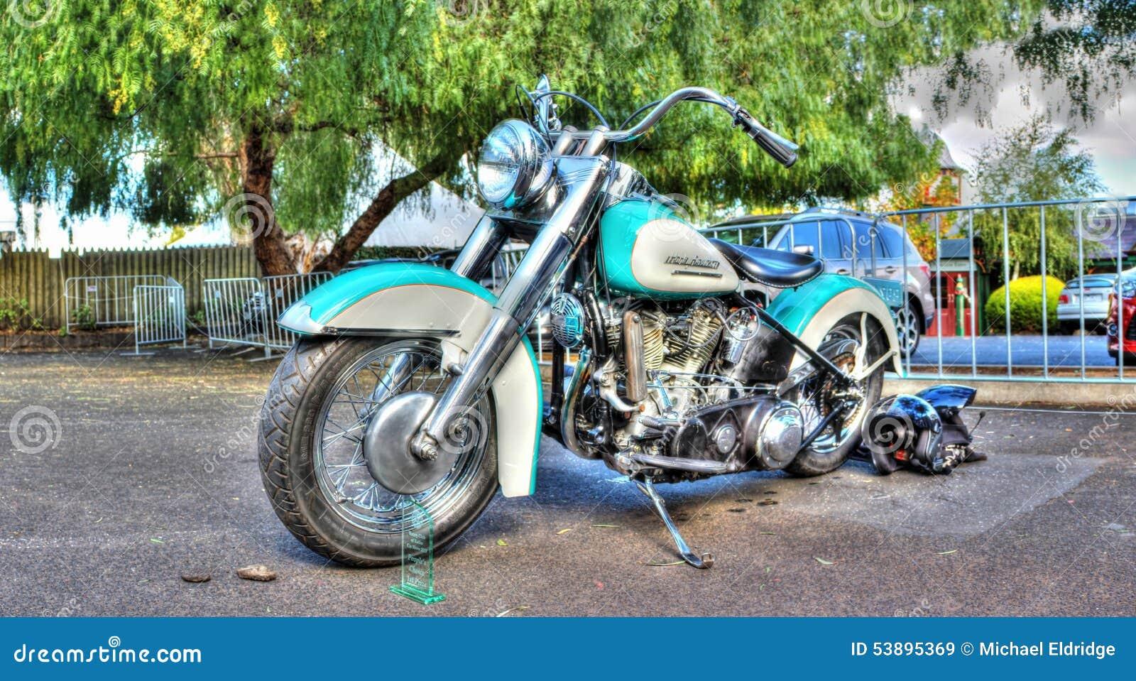 light blue and white Harley Davidson Motorbike on dsplay.