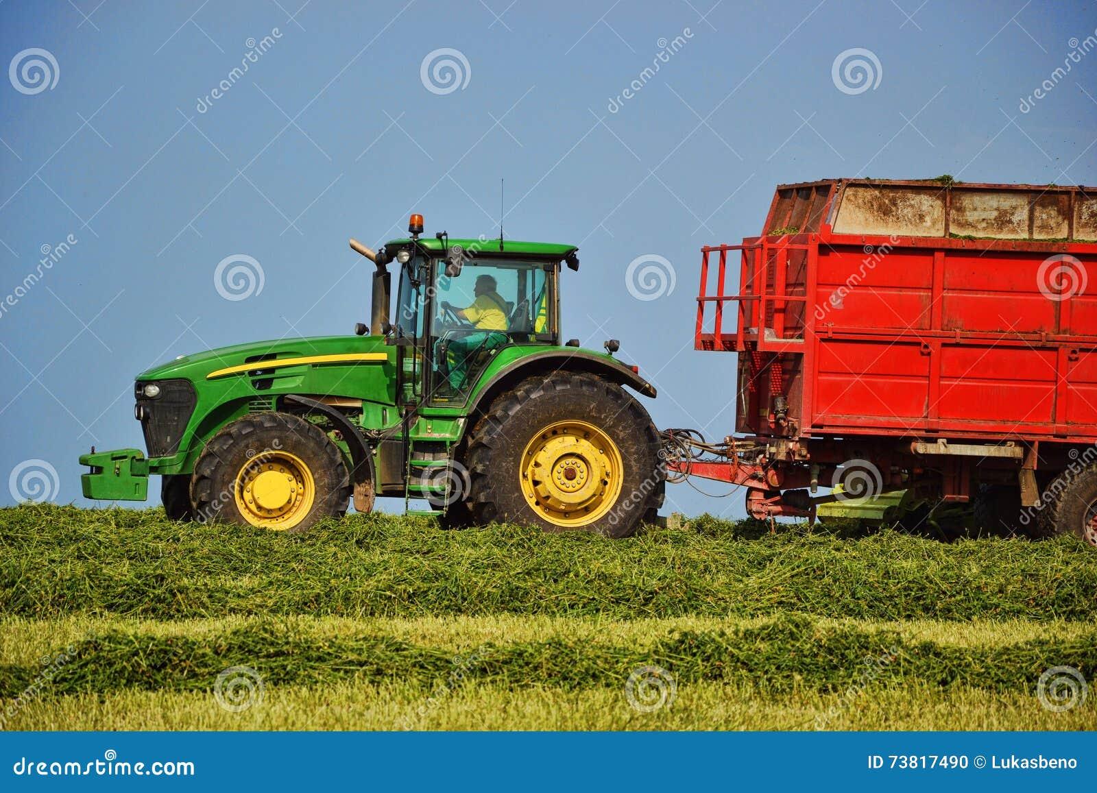 Tractor Cartoon Picker : Harvester unloading into a tractor trailer combine