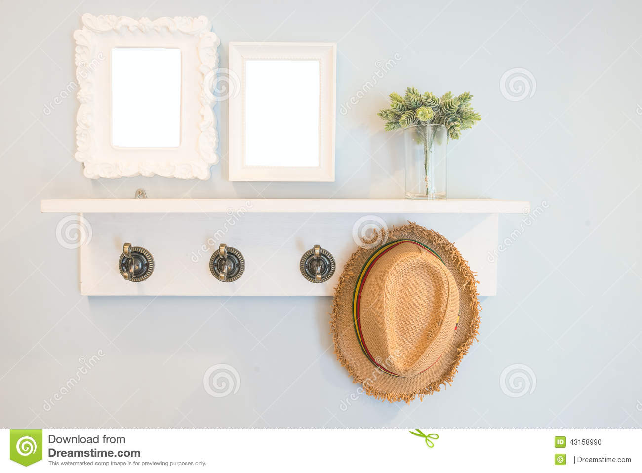 Hat hang on the wall with picture frames stock photo image of hat hang on the wall with picture frames jeuxipadfo Images