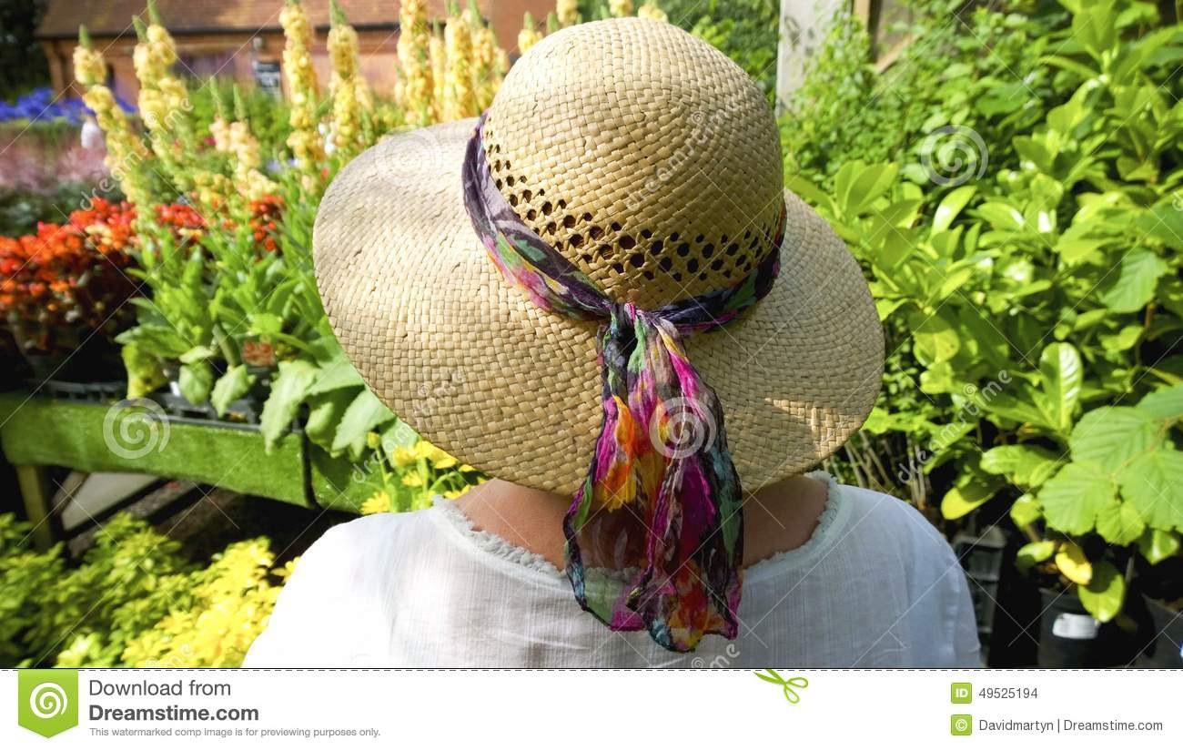 Woman in straw hat in garden - woman c6c66015ea7