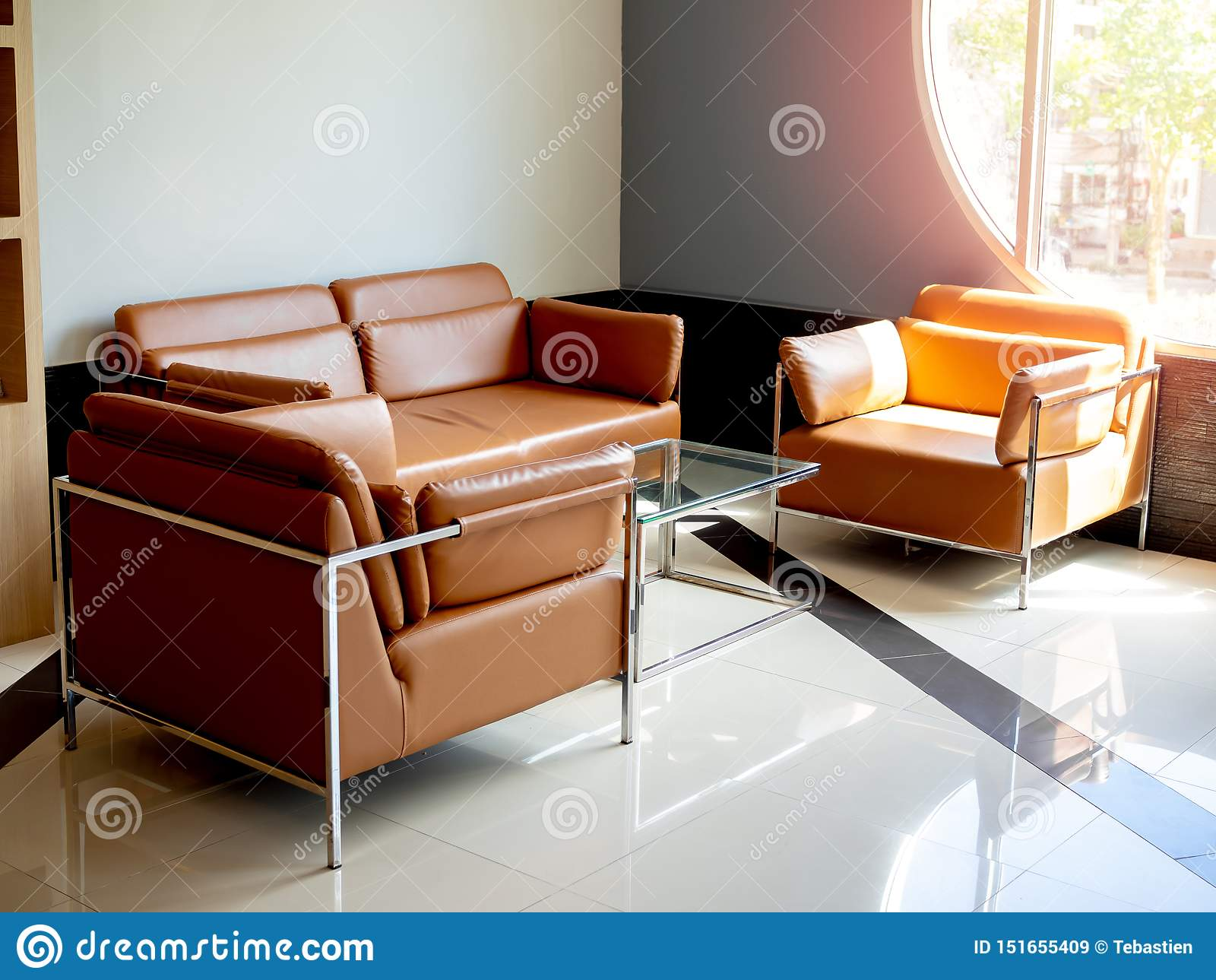 Modern Orange Leather Sofa Set With Glass Table On Blue Background