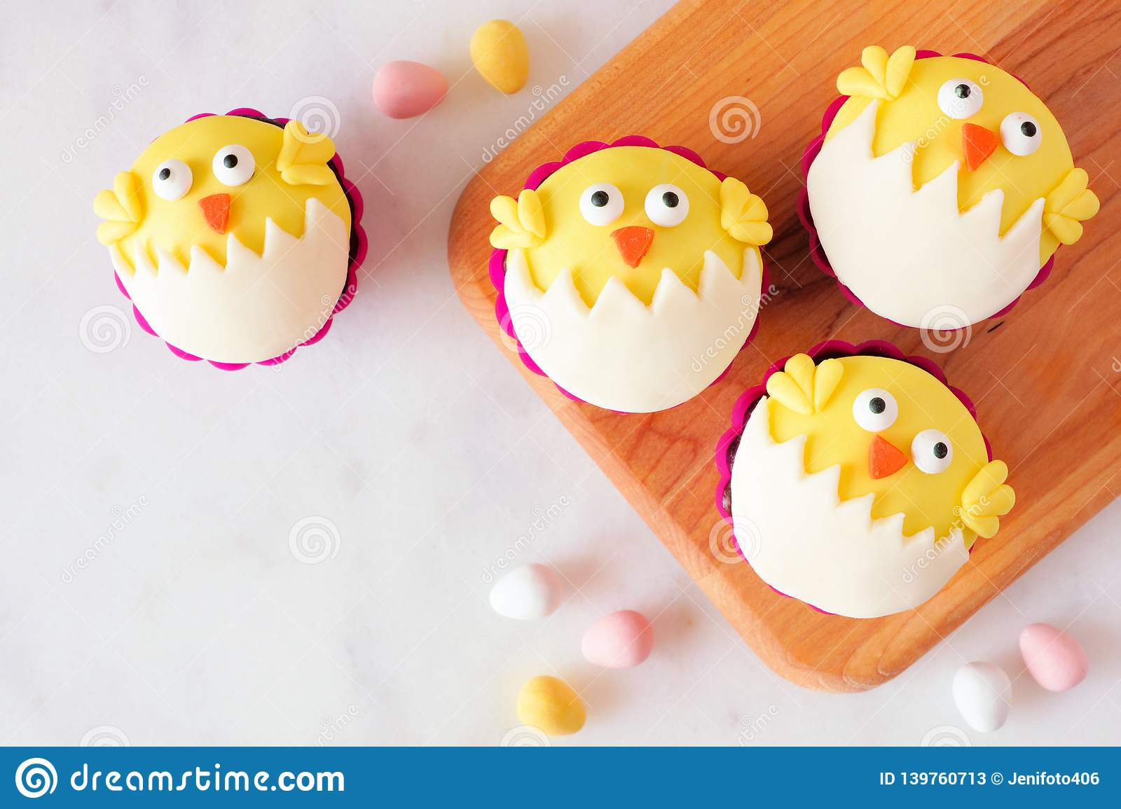 Hatching Spring Chick Cupcakes On A Wood Platter, Top View