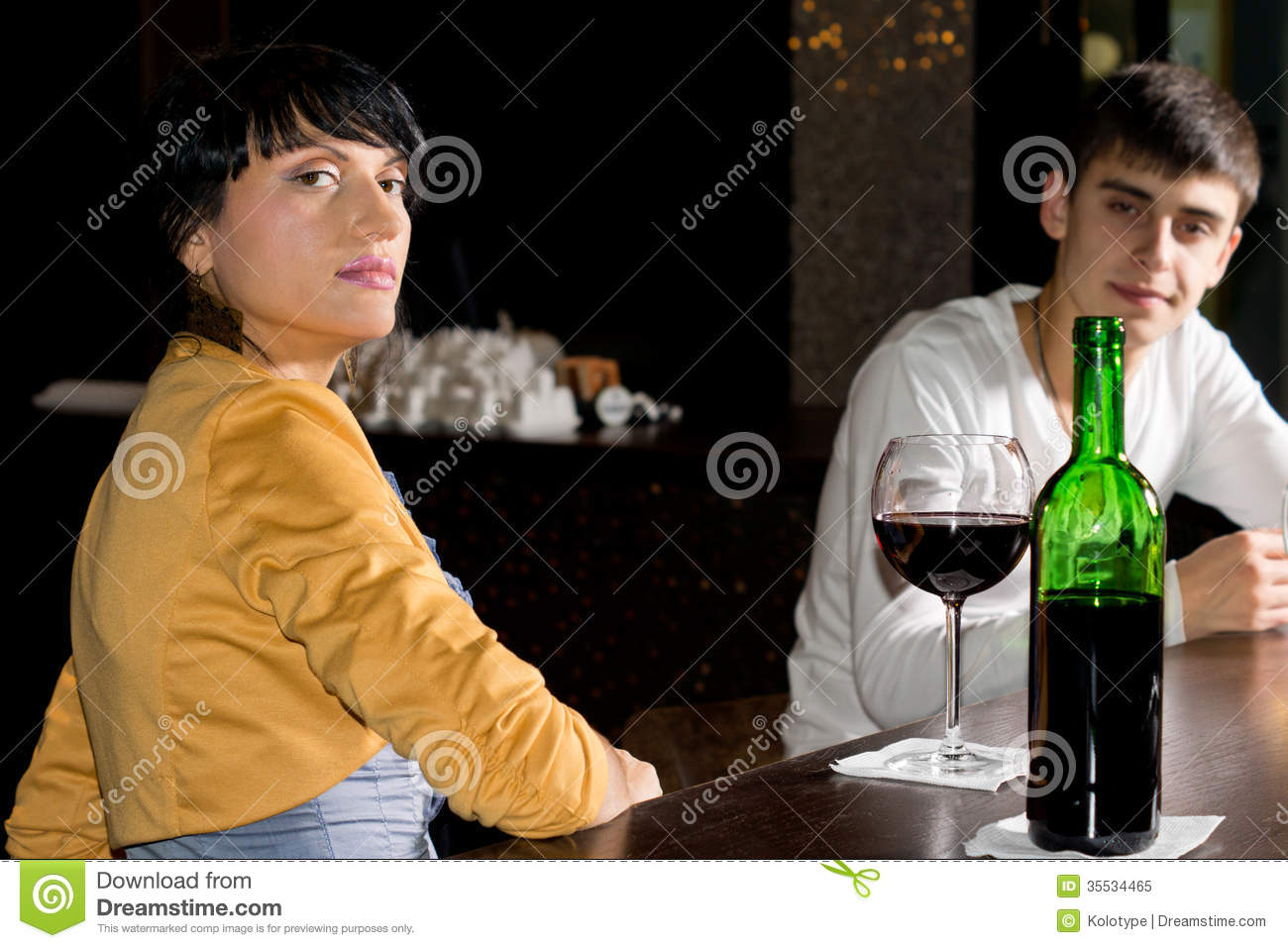 Haughty Young Woman Drinking In A Pub Royalty Free Stock ...
