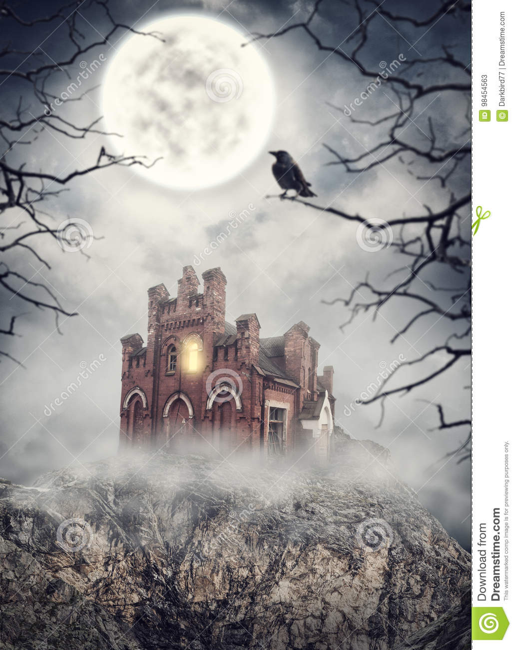 haunted abandoned house on the rock. halloween scene stock image