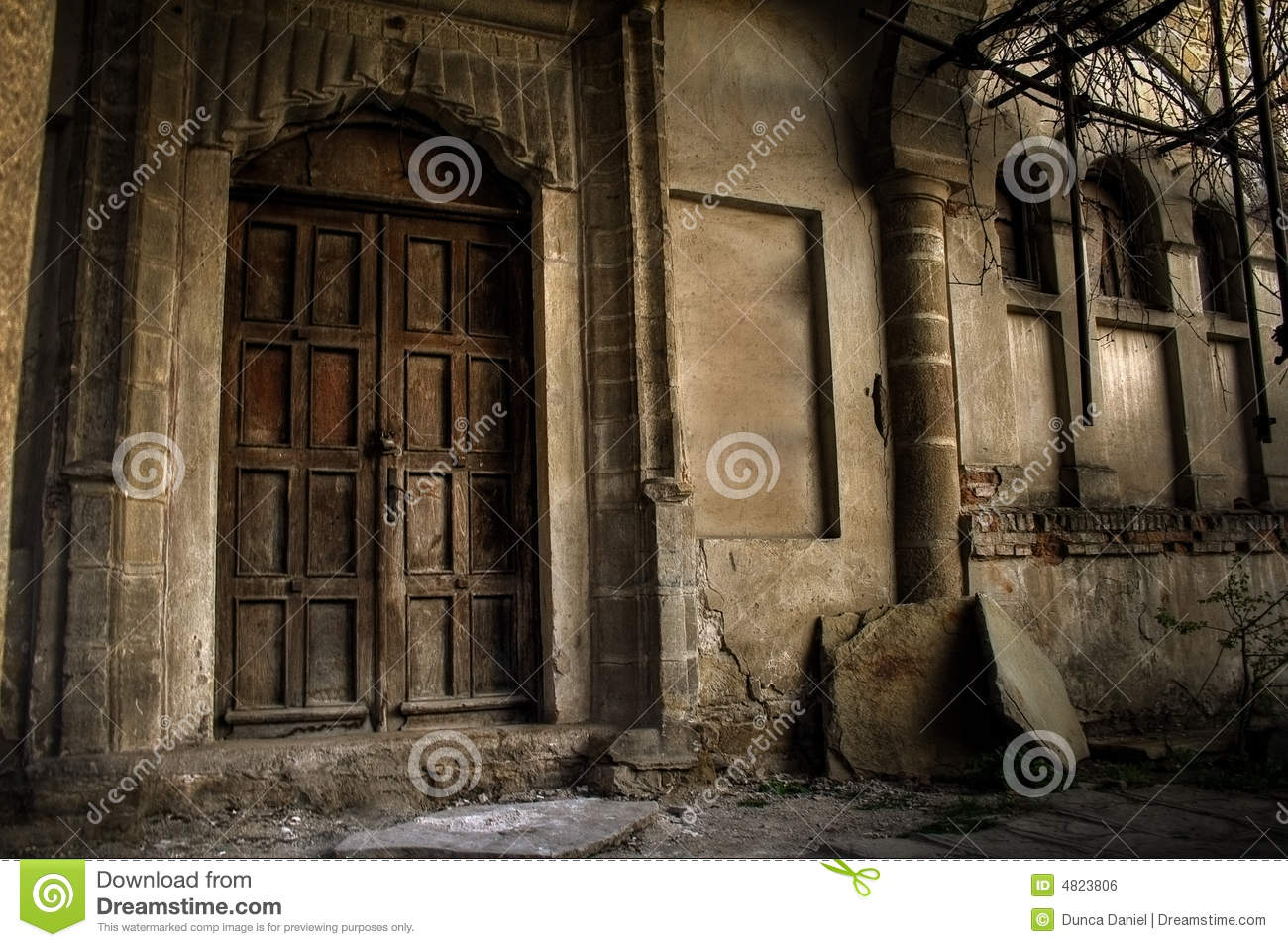 Haunted house exterior of vintage old building stock for 13 door haunted house
