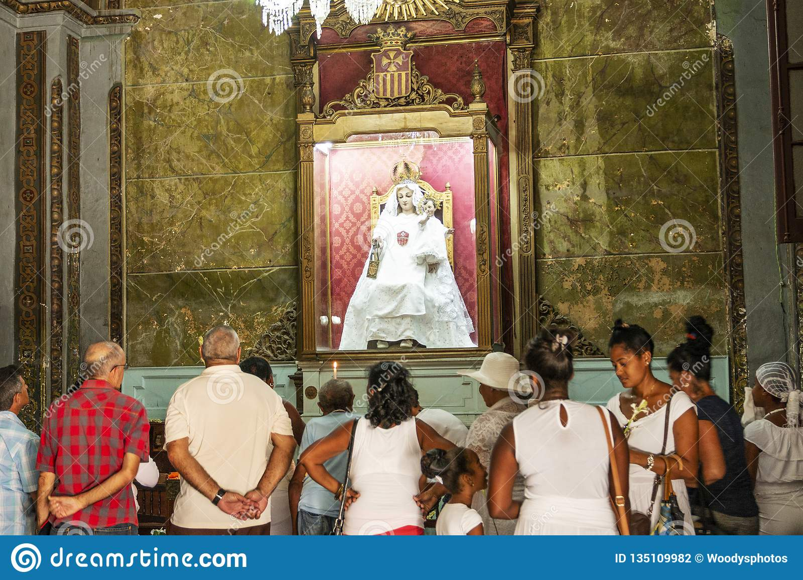 People praying in Havana Cuba church