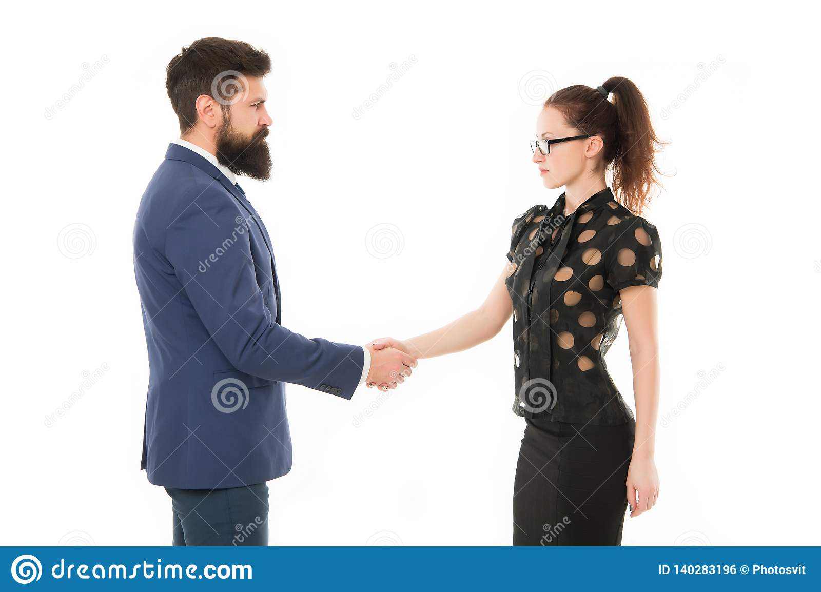 We have a deal. partnership in business. man and woman shaking hands. bearded man and woman. Business couple