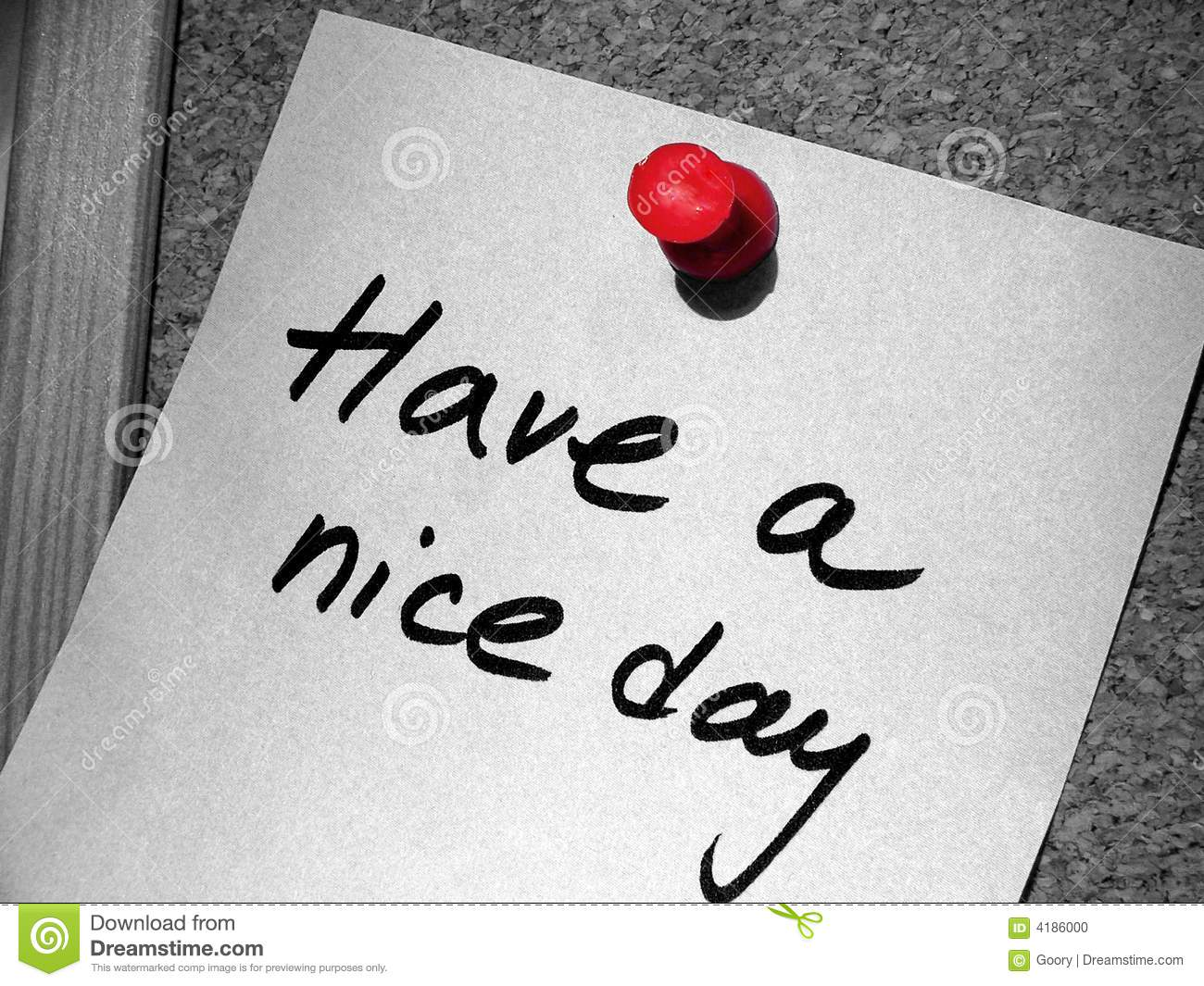 Have a nice day tag with a red pin on the cork message board.