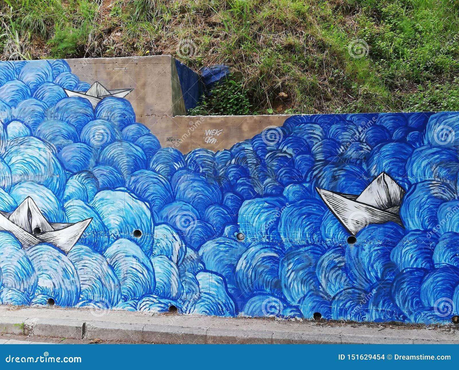Havet som målas av gatakonstnären, kan vara så härligt som verklig
