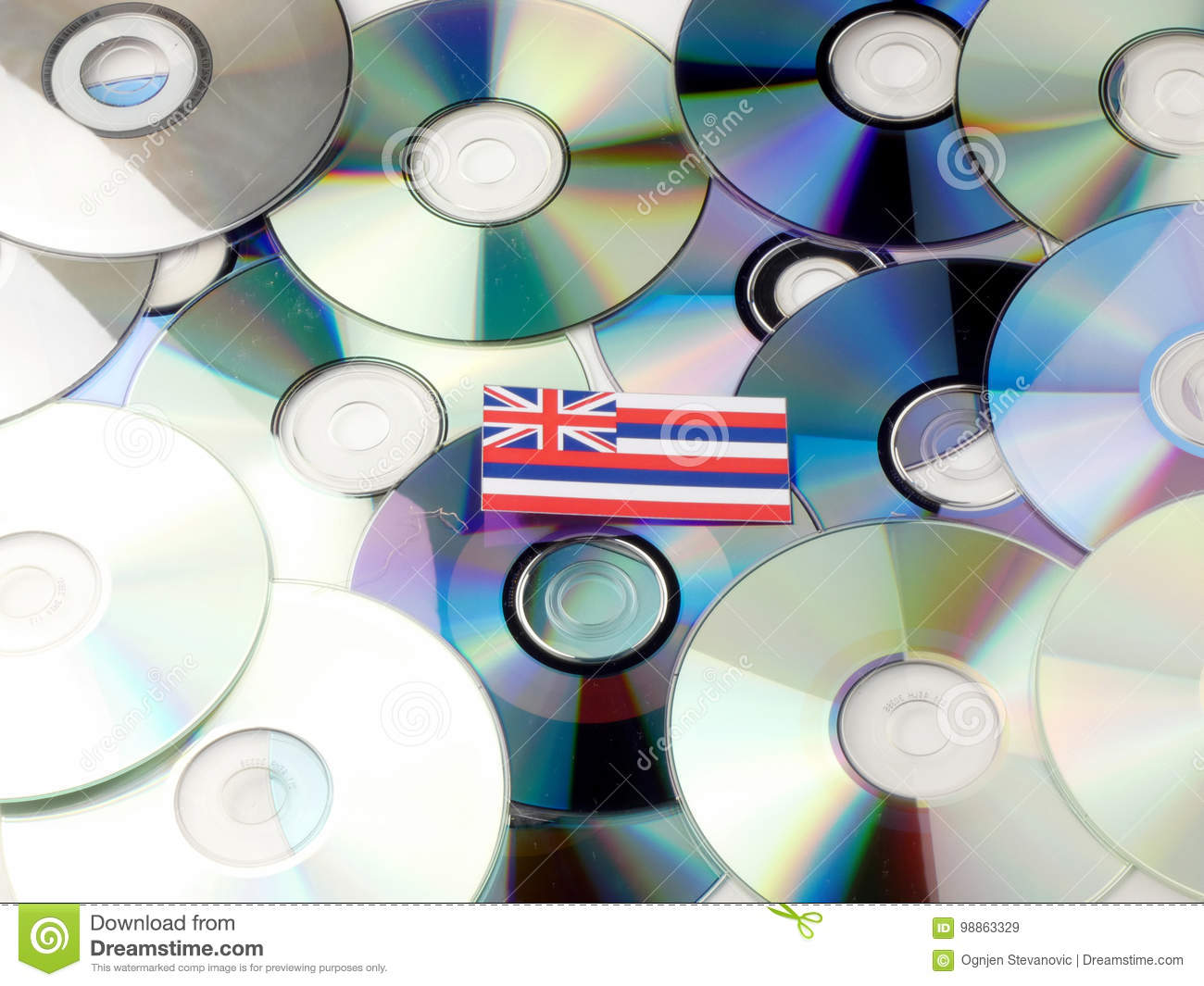 Hawaii flag on top of CD and DVD pile isolated on white