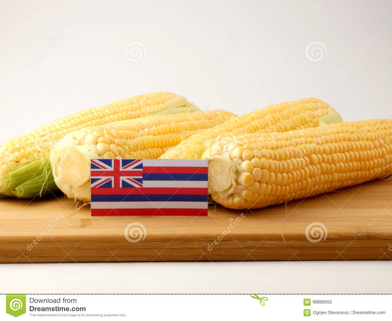 Hawaii flag on a wooden panel with corn isolated on a white back