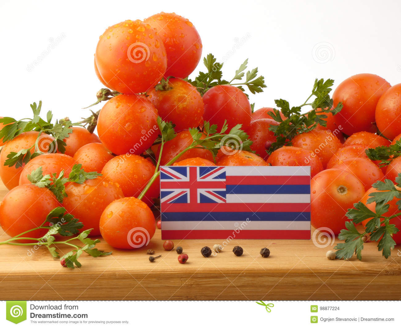 Hawaii flag on a wooden panel with tomatoes isolated on a white