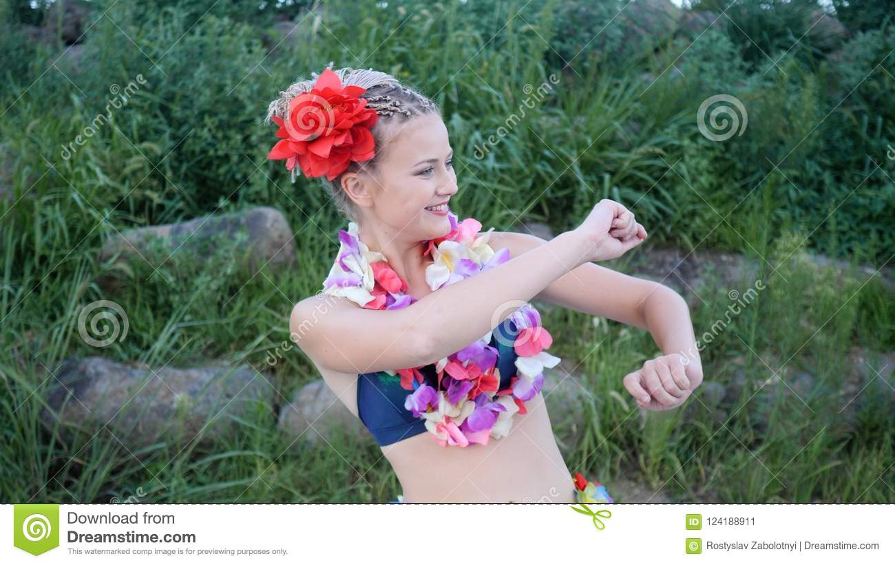 Hawaii Girl With Braided Hair And Flowers Having Fun And Silly