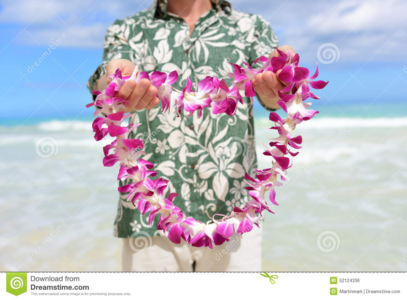 Hawaiian flowers stock photos royalty free images hawaii tradition giving a hawaiian flowers lei portrait of a male person holding a izmirmasajfo Choice Image