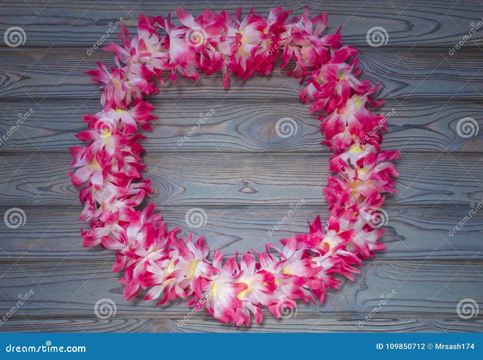 Hawaiian garland of flowers wreath on a wooden background stock download hawaiian garland of flowers wreath on a wooden background stock photo image izmirmasajfo
