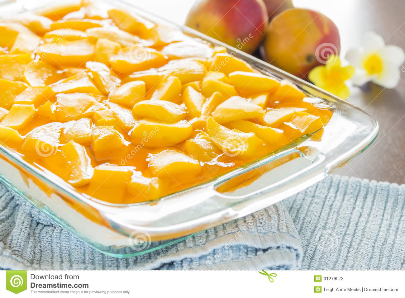 ... topped with fresh mango and orange jello with macadamia nut crust