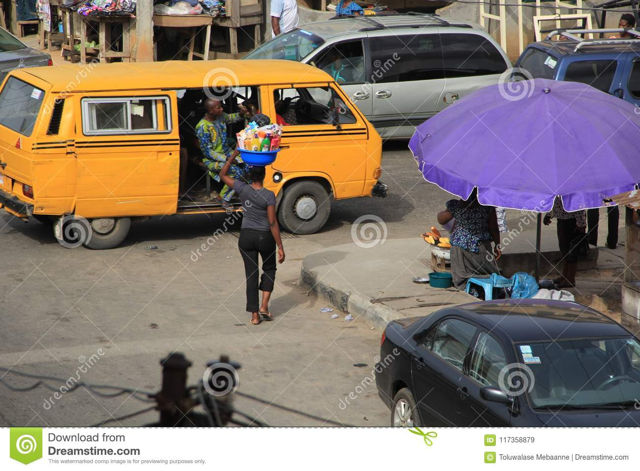 Download Hawker On The Street Of Lagos Editorial Stock Image - Image of black, labelled: 117358879