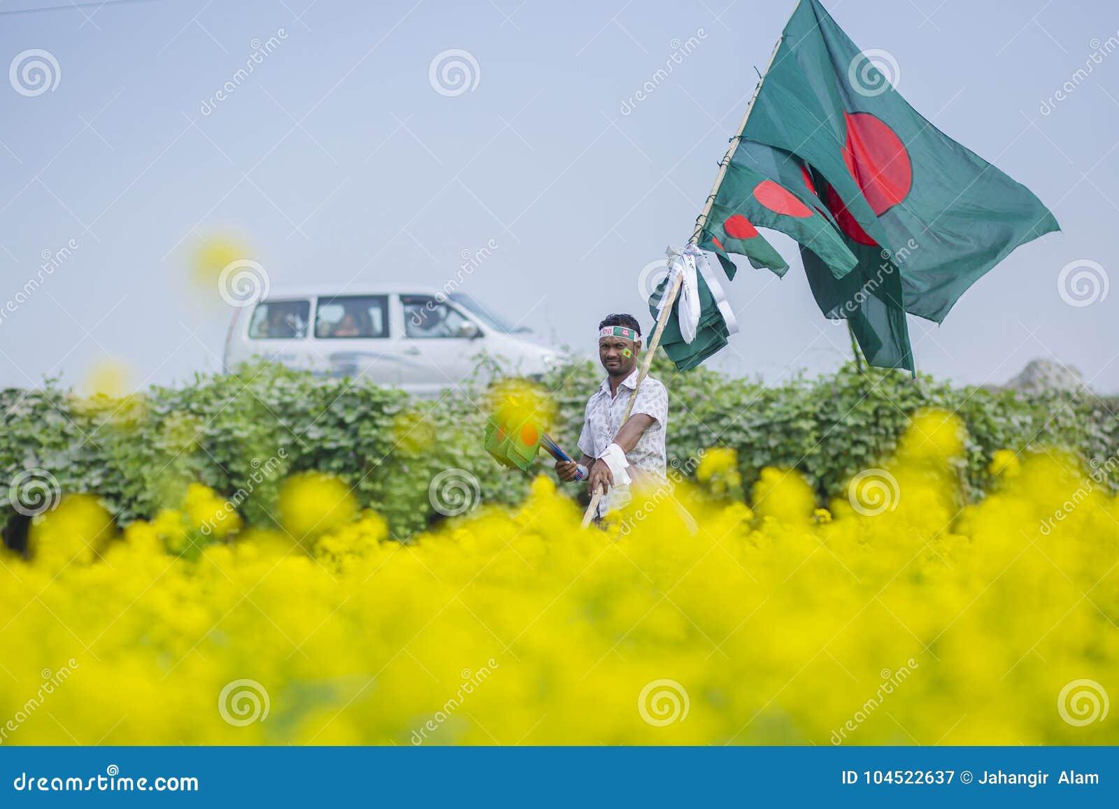 A Hawker Sells Bangladeshi National Flags At Mustard Field