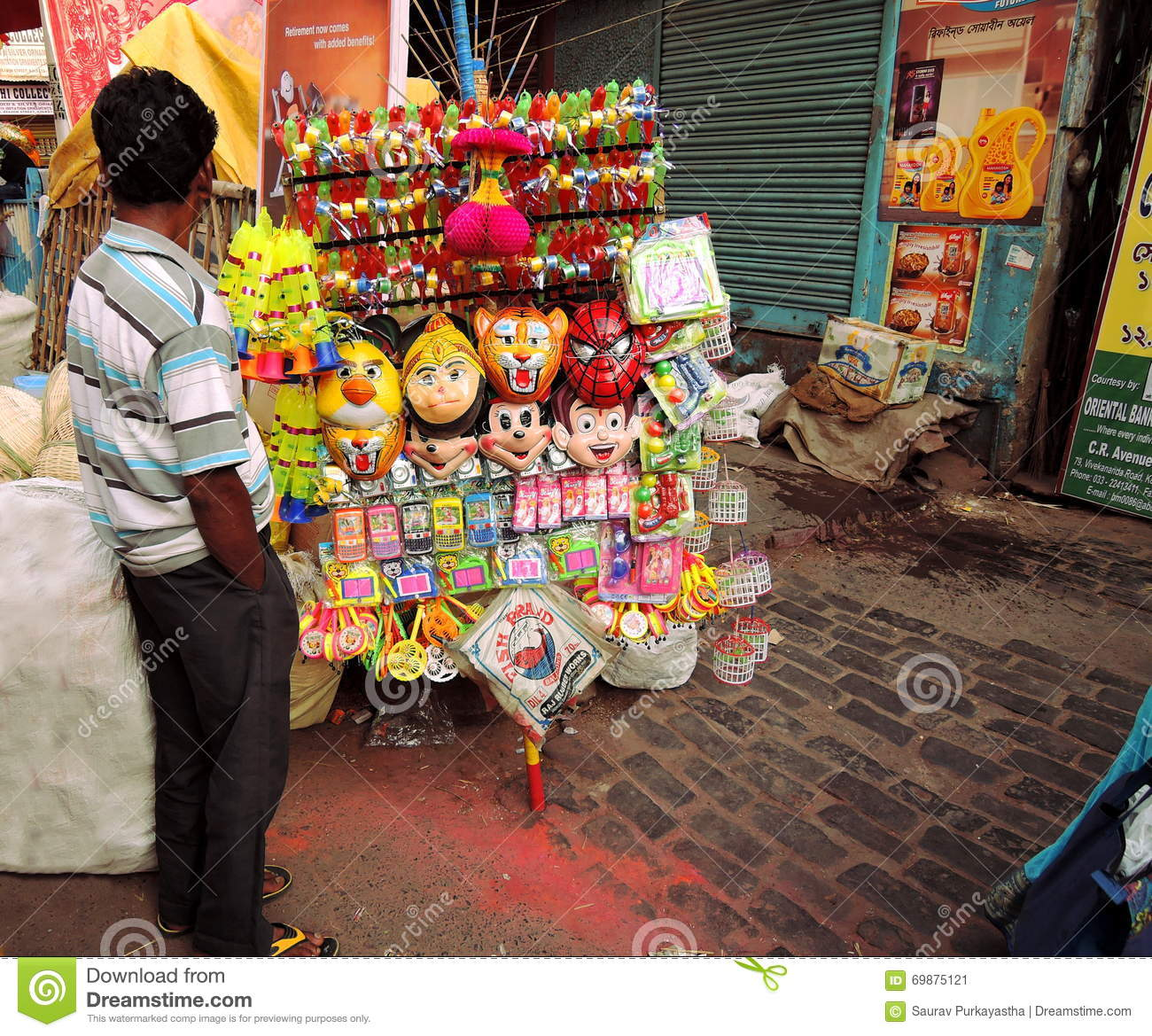 A Hawker Selling Colorful Plastic Toys Editorial Photo ...