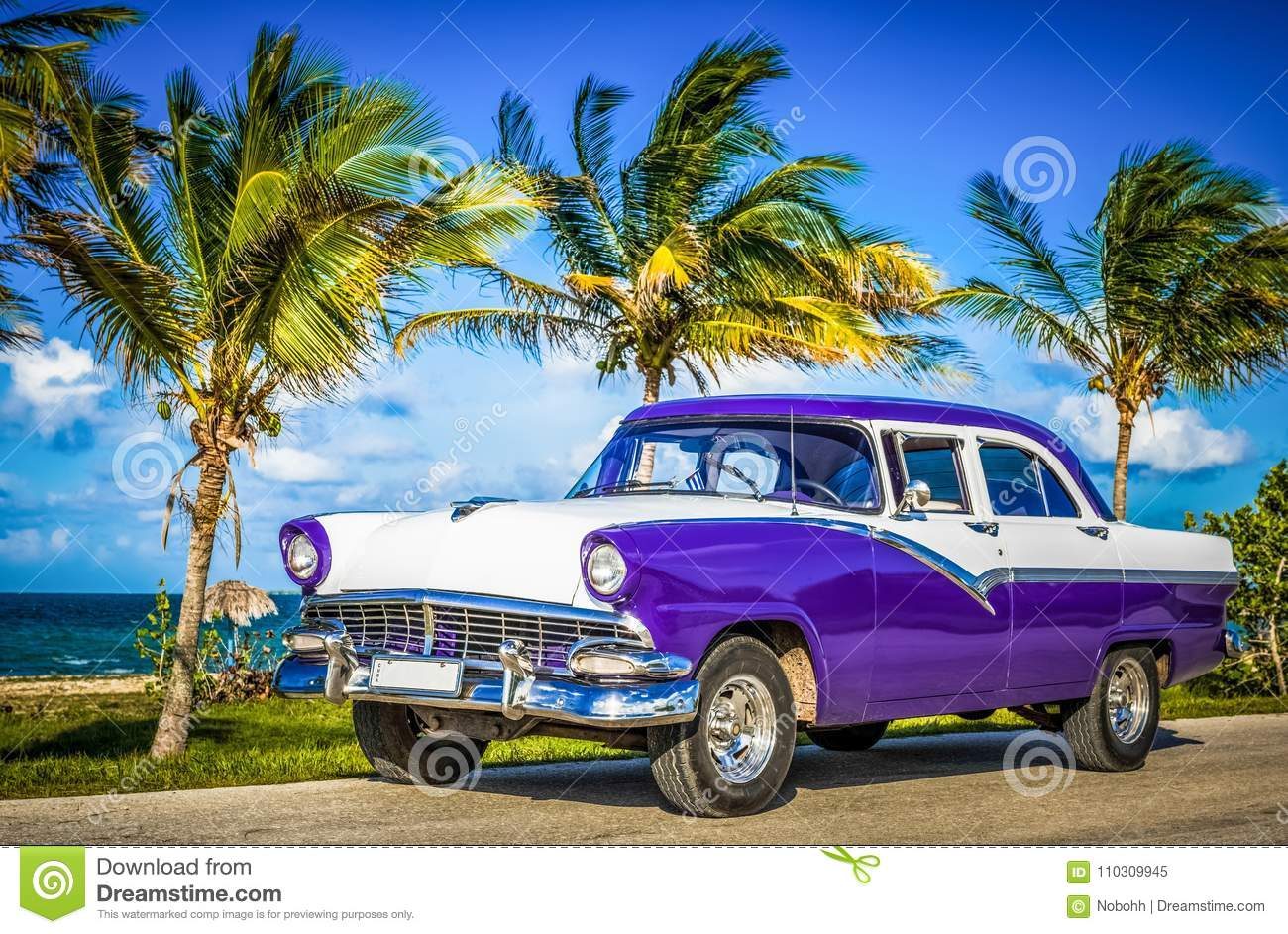 HDR - Parked american white blue vintage car in the front-side view on the beach in Havana Cuba - Serie Cuba Reportage
