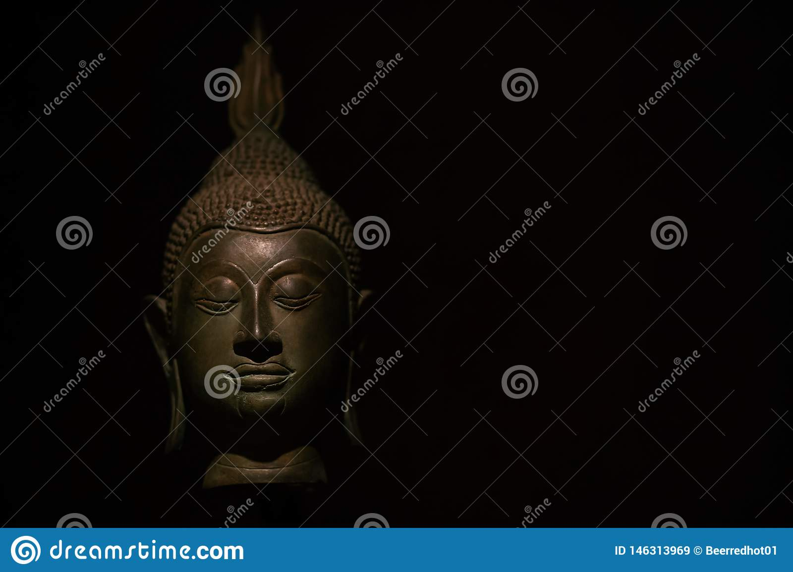 Head Buddha statue with aura used as amulets of Buddhism religion